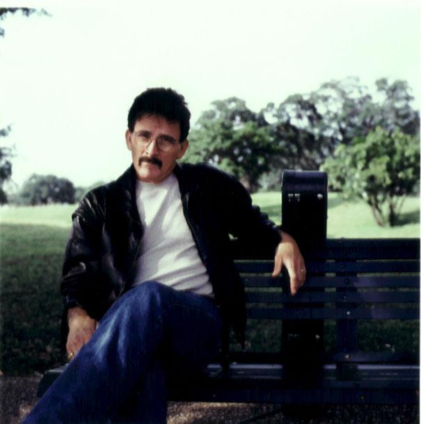 John on a park bench